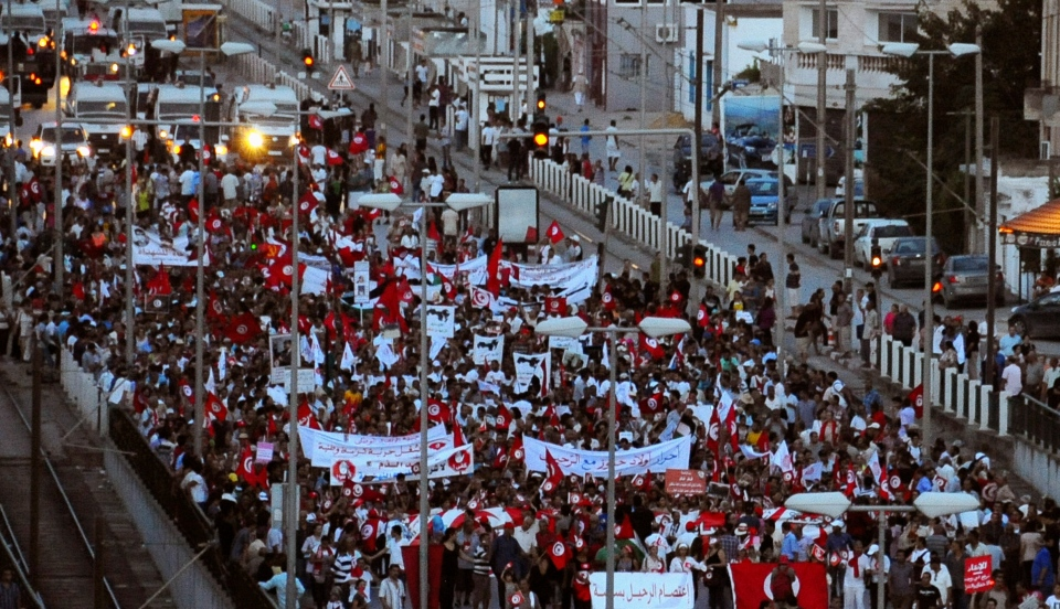 People demonstrate against Tunisia's Islamist-led government, near the Constituent Assembly headquarters in Tunis, Tunisia, Saturday Sept. 7, 2013..(AP Photo/Hassene Didri)