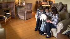 Special needs teenager Jonathan Martin (centre) may lose his one-on-one support worker when he turns 19 next month. May 31, 2011. (CTV)
