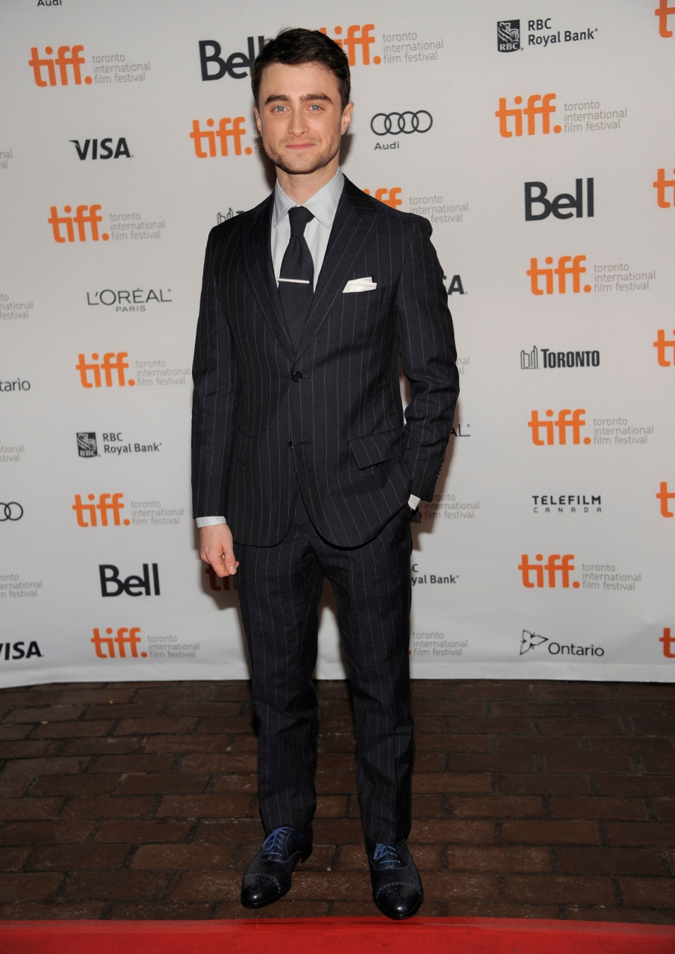 "Daniel Radcliffe arrives at the premiere of ""The F Word"" on day 3 of the Toronto International Film Festival at the Ryerson Theatre on Saturday, Sept. 7, 2013, in Toronto. (AP / Chris Pizzello)"
