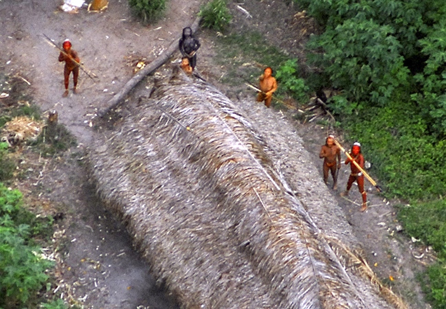 This image released by Survival International, shows uncontacted Indians of the Ethno-Environmental Protected Area along the Envira river, in the Brazilian state of Acre, close to the border with Peru, photographed during a flight in May 2008.