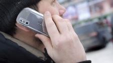 A man speaks on his a cell phone outside Helsinki railway station on Jan. 27, 2011. (AP / LEHTIKUVA, Jarno Mela)