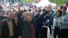 Winnipeg Mayor Sam Katz leads a conga line at The Forks following the announcement of the NHL returning to Winnipeg.
