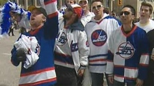 Hockey fans gathered Tuesday morning at Portage and Main to celebrate the news an NHL franchise was returning to Winnipeg.