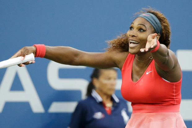 Serena Williams reacts after a point