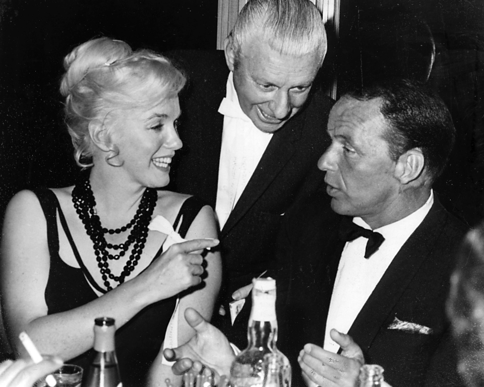 Marilyn Monroe talks with Frank Sinatra while an unidentified man looks on at the Cal Neva Lodge in in Crystal Bay, Nevada, in 1959. (Reno Gazette Journal, Don Dondero)