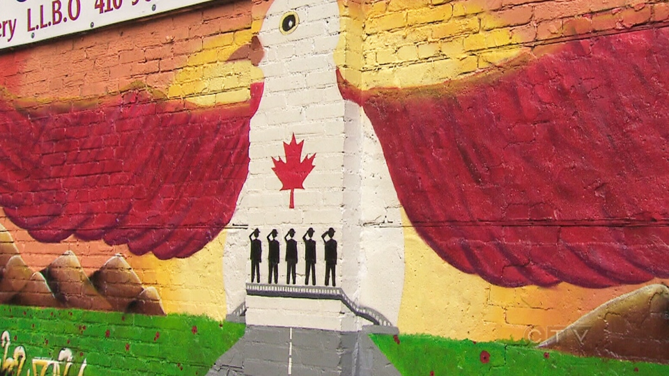 A mural paying tribute to Canada's fallen soldiers is shown before it was vandalized.