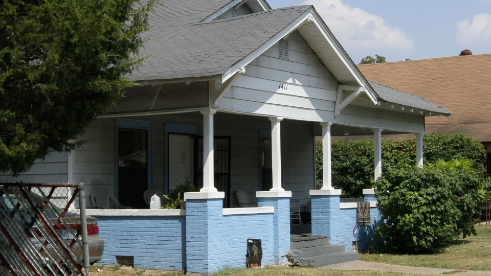A house that was the scene of the Saturday shooting death of an elderly man is shown in Pine Bluff, Ark. on Sunday, Sept. 8, 2013. (AP / Danny Johnston)