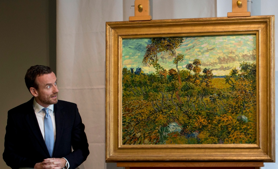 Van Gogh Museum director Axel Ruger looks at 'Sunset at Montmajour' after unveiling the painting by Dutch painter Vincent van Gogh during a press conference at the museum in Amsterdam, Netherlands, Monday Sept. 9, 2013. (AP / Peter Dejong)