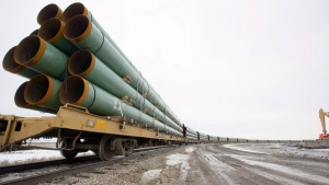 In this Feb. 28, 2008 file photo, rail cars arrive in Milton, N.D., loaded with pipe for TransCanada's Keystone Pipeline project, which carries crude oil across Saskatchewan and Manitoba, and through North Dakota, South Dakota, Nebraska, Kansas, Missouri and Illinois. (Grand Forks Herald, Eric Hylden THE CANADIAN PRESS / AP)