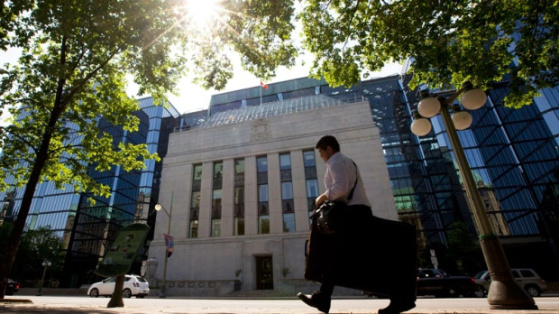 A man walks past the Bank of Canada in Ottawa, Tuesday May 31, 2011.  (Adrian Wyld / THE CANADIAN PRESS)