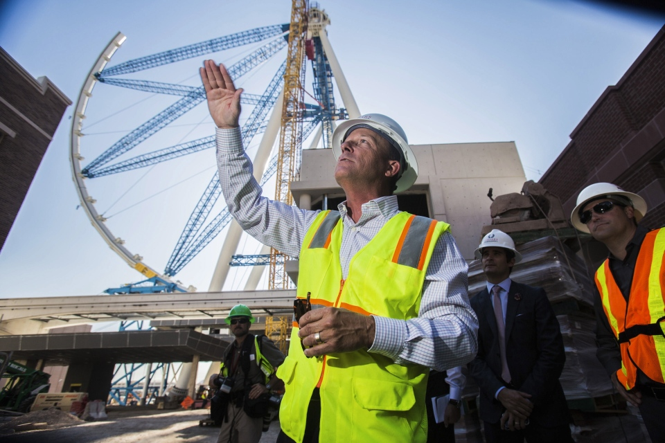 The world's tallest observation wheel, know as the High Roller is seen behind David Codiga, executive project director for The Linq, at The Linq construction site on Las Vegas Boulevard in this Tuesday, July 30, 2013 file photo. (AP)