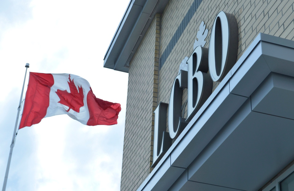 A Canadian flag flies near an under construction LCBO store in Bowmanville, Ontario on Saturday July 20, 2013. (Doug Ives / THE CANADIAN PRESS)