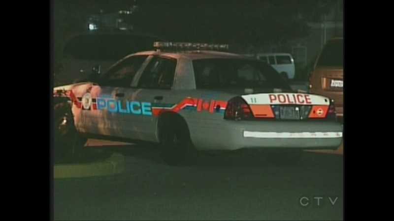 A London police cruiser sits outside the hotel where a man's body was found in south London, Ont. on Sunday, Sept. 8, 2013.