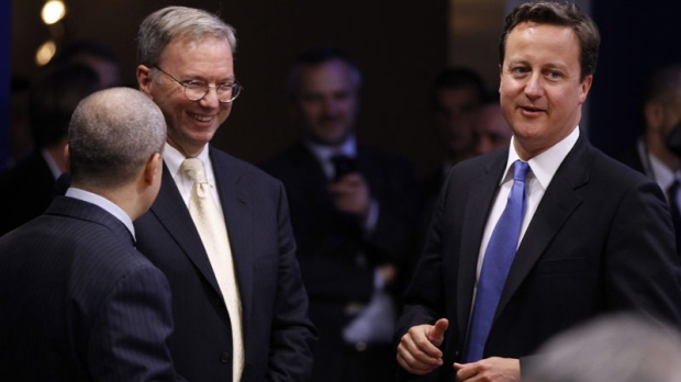 Britain's Prime Minister David Cameron, right, talks with Google chairman Eric Schmidt at a working session on Internet issues at the G8 summit in Deauville, France, Thursday, May 26, 2011. (AP Photo/Charles Dharapak)