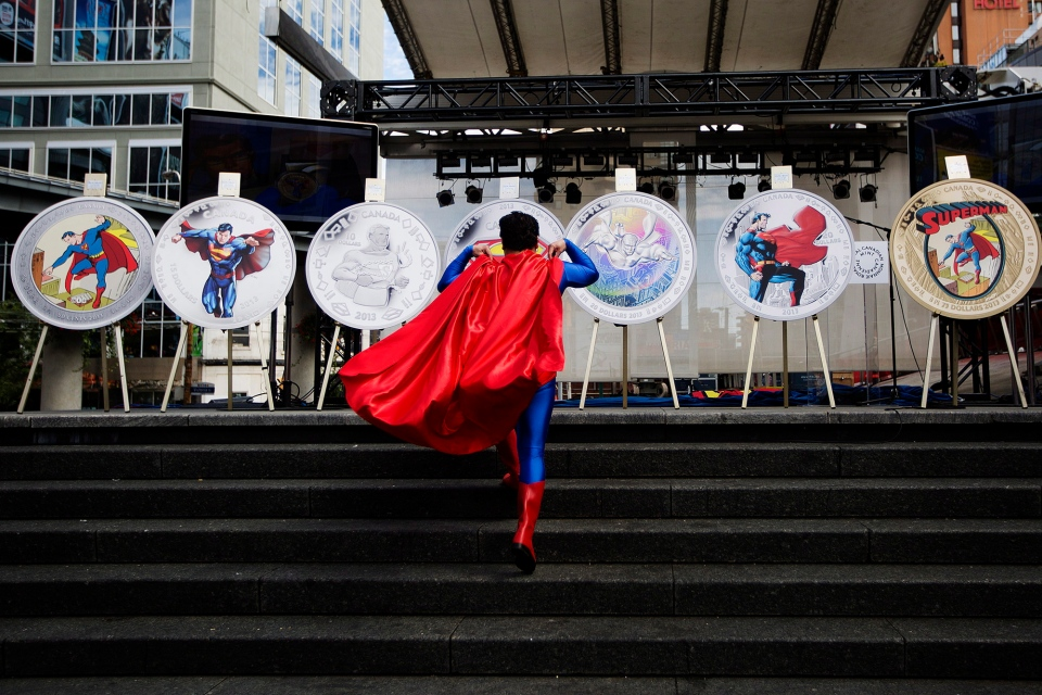 Superman fan Norman Antonio wears a costume as he attends the unveiling of the Royal Canadian Mint's Superman commemorative coins in Toronto on Monday, Sept. 9, 2013. (Michelle Siu / THE CANADIAN PRESS)