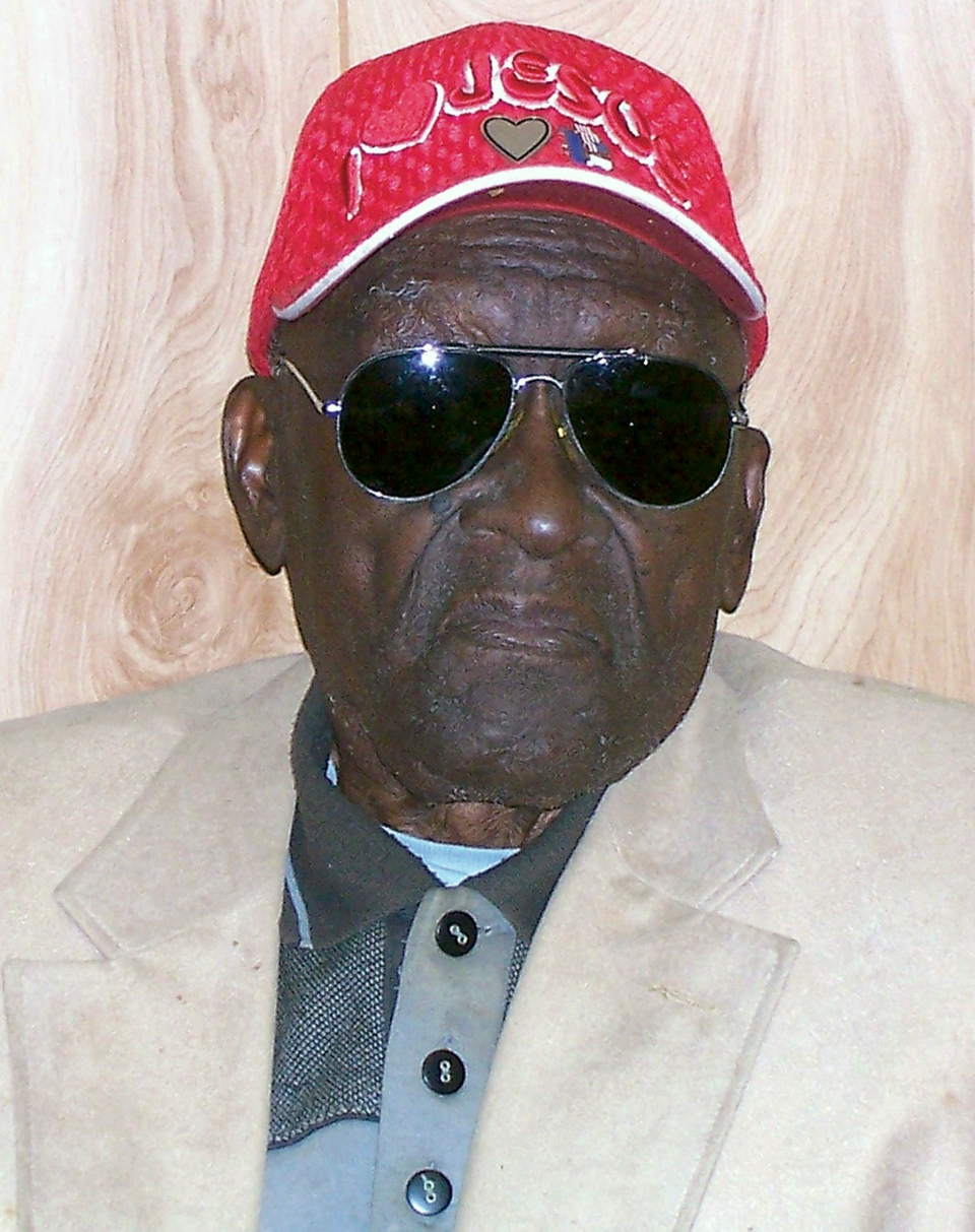 In this 2011 photo provided by the Pine Bluff Commercial, Monroe Isadore poses for photos on his 105th birthday in Pine Bluff, Ark. Authorities in Arkansas halted a standoff on Saturday, Sept. 7, 2013, when they shot and killed Isadore, 107, who opened fire at them. (Courtesy Pine Bluff Commercial)