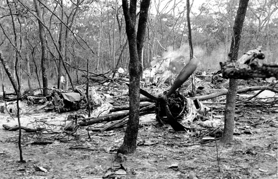 Sept. 19, 1961 file photo: Searchers walk through the scattered wreckage of the DC6B plane carrying Dag Hammarskjold in a forest near Ndola, Zambia. Widely considered the U.N.'s most effective chief, Hammarskjold died as he was attempting to bring peace to the newly independent Congo. (AP)