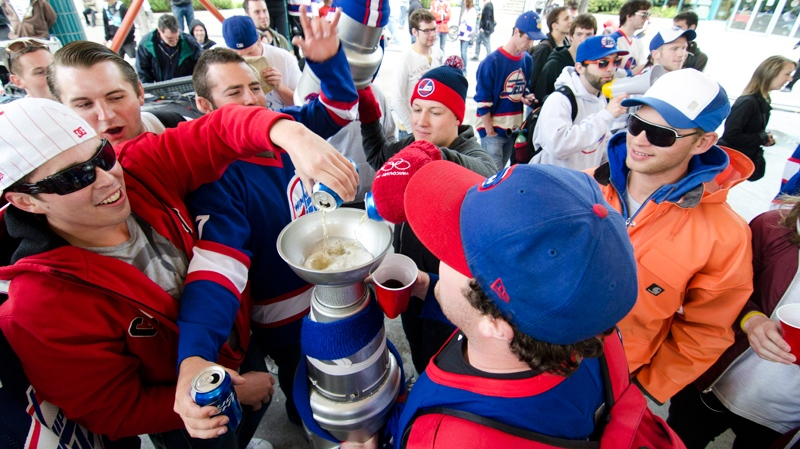 Winnipeg hockey supporters rally at The Forks in Winnipeg, Tuesday May 31, 2011 after the announcement that an NHL team will be returning to the city after 15 years. (David Lipnowski / THE CANADIAN PRESS)