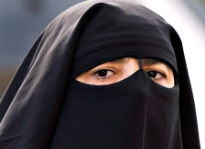 A woman wears a niqab