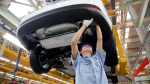 A worker assembles a vehicle on an assembly line at Ford factory in Chongqing, China Tuesday, April 16, 2013.  (AP Photo)