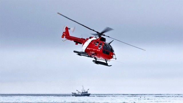 A Canadian Coast Guard helicopter mid-flight in the during a mission in Canada's Arctic. (Bernard Parizeau / Department of Fisheries and Oceans)