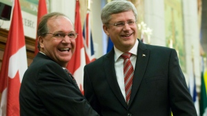 Prime Minister Stephen Harper welcomes new MP Bernard Valcourt at the start of caucus meetings in Ottawa, Wednesday June 1, 2011. (Adrian Wyld / THE CANADIAN PRESS)