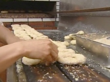 An employee of Montreal's Fairmount Bagel prepares the famous baked goods on Sunday, June 1, 2008.
