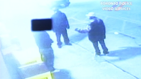 Toronto police have released security camera footage and images of two suspects wanted in connection with the shooting death of John Kang, 21.