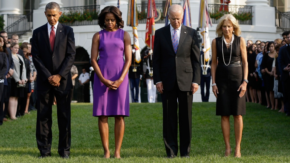 U.S. President Barack Obama, Michelle Obama, U.S. Vice President Joe Biden and Jill Biden participate in a moment of silence on the anniversary of 9-11 outside the White House, Wednesday, Sept. 11, 2013. (AP / Pablo Martinez Monsivais)