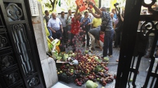 Protesting farmers dump some 300 kilos (700 pounds) of fruit and vegetables, cabbage, tomatoes, peppers, cucumbers and other produce outside the German consulate in Valencia, Spain Thursday June 2, 2011. (AP / Robert Solsona)