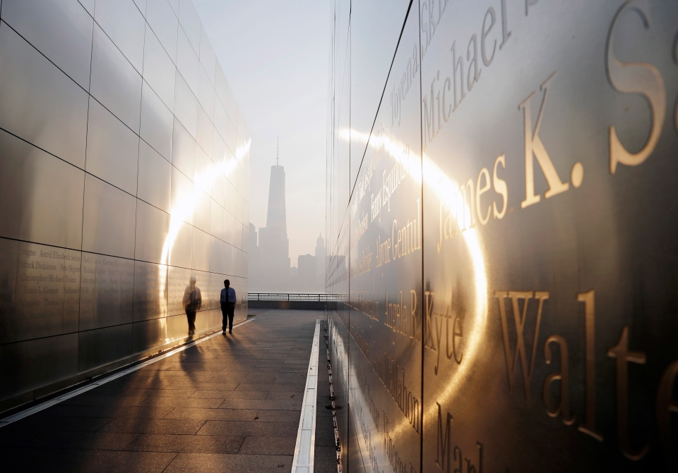 A visitor walks through the 'Empty Sky' memorial to New Jersey's victims of the Sept. 11, 2001 terrorist attacks on Wednesday, Sept. 11, 2013, in Jersey City, N.J. One World Trade Center is visible across the Hudson River. (AP / Mel Evans)