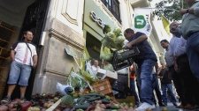 Protesting farmers dump some 300 kilos (700 pounds) of fruit and vegetables, cabbage, tomatoes, peppers, cucumbers and other produce outside the German consulate in Valencia, Spain Thursday, June 2, 2011. Spain says it is not ruling out taking legal action against German authorities for blaming Spanish vegetables for the E.coli outbreak that has killed 16 people. (AP / Robert Solsona)