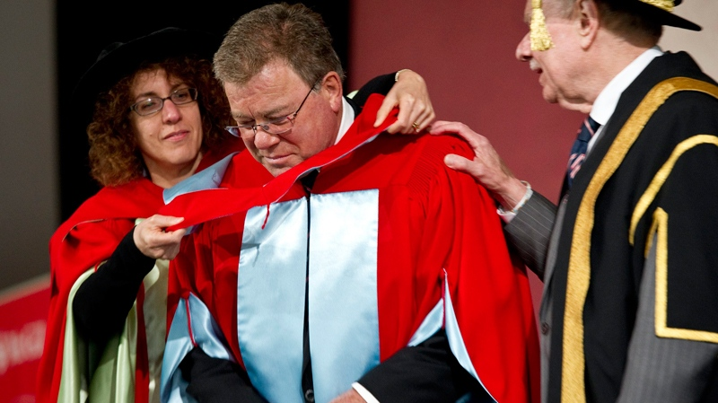 William Shatner is hooded by professor Victoria Kapsi and and congratulated by chancellor Arnold Steinberg as he receives an honorary degree from his alma mater McGill University, on Thursday, June 2, 2011 in Montreal. (Paul Chiasson / THE CANADIAN PRESS)