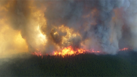 Gusty winds and dry weather have created a dangerous ground situation for firefighters at a blaze near Tisigar Lake. June 1, 2011. (Wildfire Management Branch)