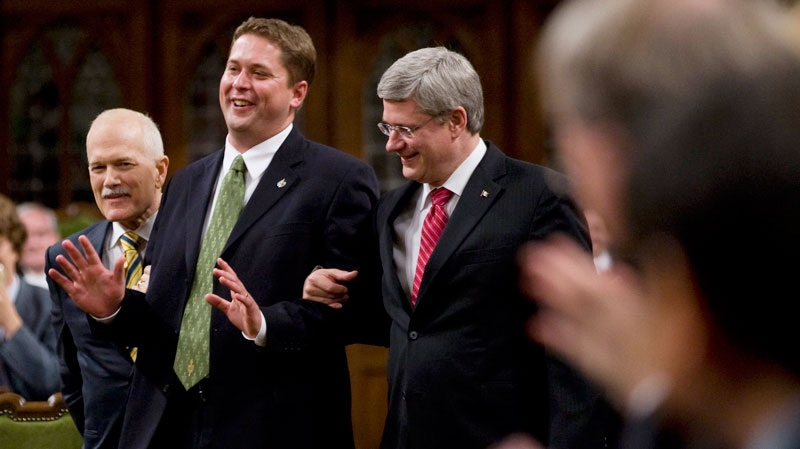 Speaker of the House of Commons Andrew Scheer jokingly tries to fight with Prime Minister Stephen Harper and NDP leader Jack Layton as they escort him to the Speakers chair in the House of Commons on Parliament Hill in Ottawa, Thursday June 2, 2011. (Adrian Wyld / THE CANADIAN PRESS)