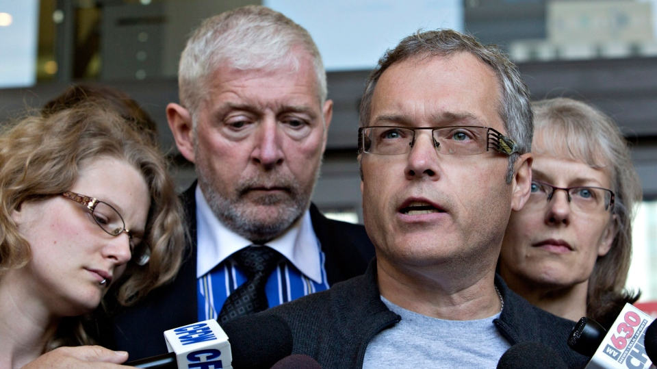 John Ernst, right, uncle of Michelle Shegelski, and family members speak to media after the sentencing of Travis Baumgartner in Edmonton, Alberta on Wednesday September 11, 2013. (Jason Franson / THE CANADIAN PRESS)
