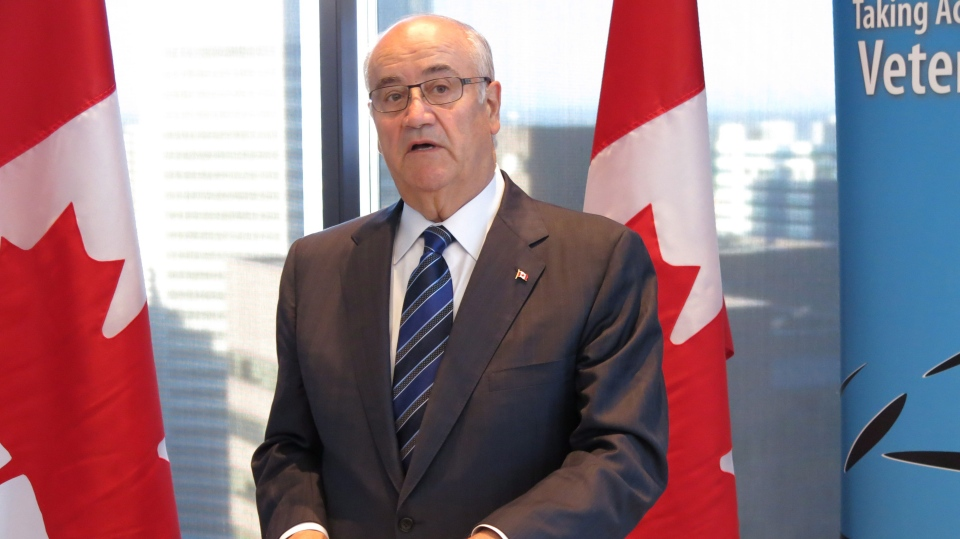 Federal Veterans Affairs Minister Julian Fantino speaks in Calgary on Wednesday, Sept. 11, 2013. (Bill Graveland / THE CANADIAN PRESS)