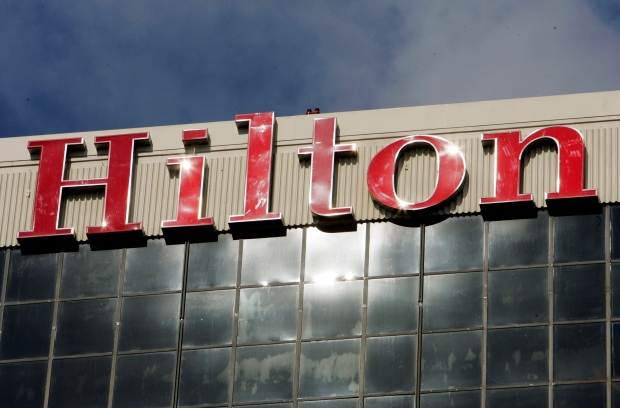 FILE - The sign atop the Hilton Los Angeles Airport hotel is seen in this Wednesday, Jan. 31, 2007 file photo. (AP Photo/Reed Saxon, File)