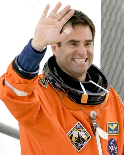 Mission Specialist Greg Chamitoff waves as he heads to the launch pad at the Kennedy Space Center in Cape Canaveral, Fla., on Saturday May 31, 2008 (AP / Chris O'Meara)