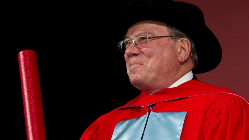 William Shatner salutes the crowd after receiving an honourary degree from McGill University, his alma mater, Thursday, June 2, 2011 in Montreal. (Paul Chiasson / THE CANADIAN PRESS)