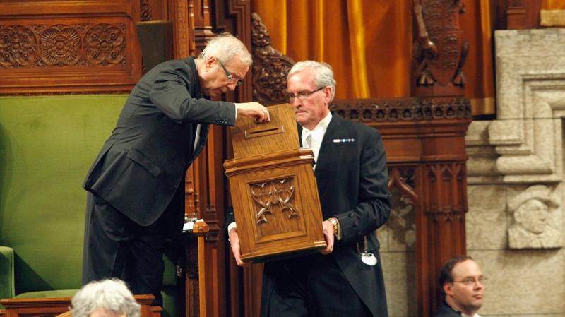 Presiding MP Louis Plamondon checks a ballot box before the vote for Speaker of the House of Commons in Ottawa on Thursday, June 2, 2011. (Adrian Wyld / THE CANADIAN PRESS)
