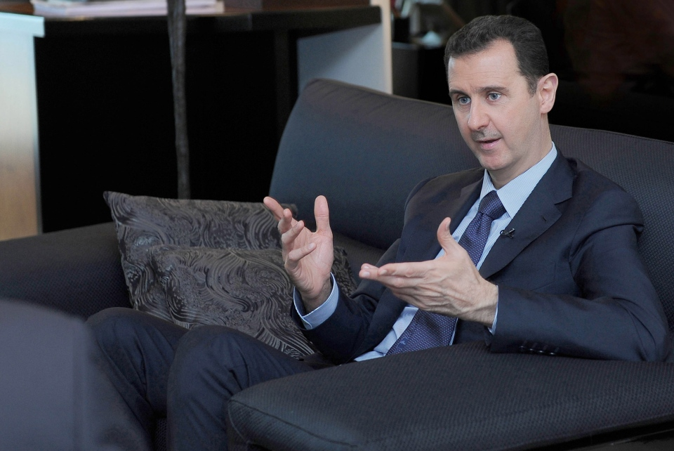 In this Monday, Aug. 26, 2013 file photo released by the Syrian official news agency SANA, Syrian President Bashar Assad gestures as he speaks during an interview with a Russian newspaper, in Damascus. (AP Photo/SANA)