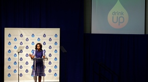 First lady Michelle Obama speaks during an event at Watertown High School to encourage people to drink more water, Thursday, Sept. 12, 2013, in Watertown, Wis. (AP / Morry Gash)