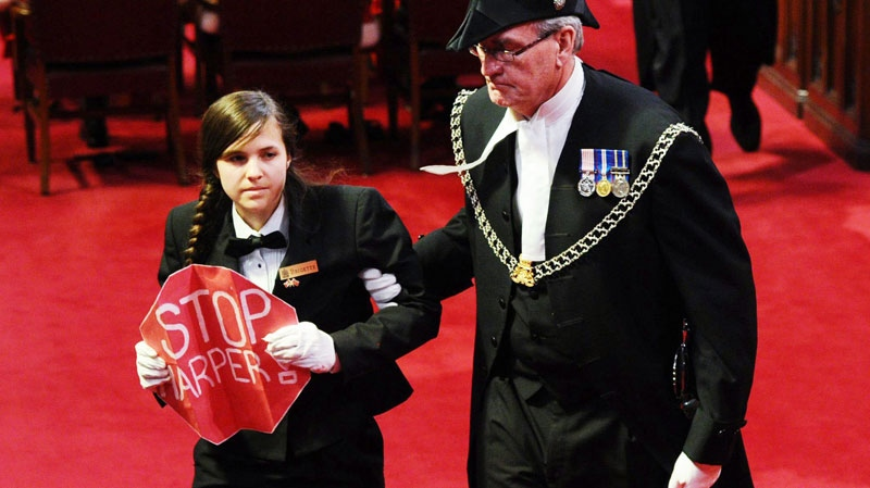 Sergeant at Arms Kevin Vickers escorts a protester from the floor of the Senate as Gove. Gen. David Johnston delivers the Speech from the Throne on Parliament Hill in Ottawa, Friday June 3, 2011. (Sean Kilpatrick / THE CANADIAN PRESS)