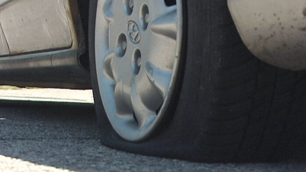 One of about three dozen tires slashed in Ingersoll, Ont. is seen on Friday, June 3, 2011.