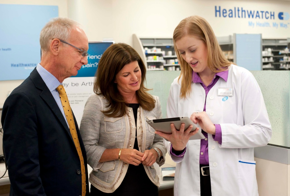 Rona Ambrose, Minister of Health (centre), reviews the new innovative Shoppers Drug Mart Arthritis Screening tool with Dr. John Esdaile, Scientific Director of Arthritis Research Centre of Canada, and pharmacist Amanda Perry, in Toronto, Monday, Sept. 9, 2013. (Shoppers Drug Mart)