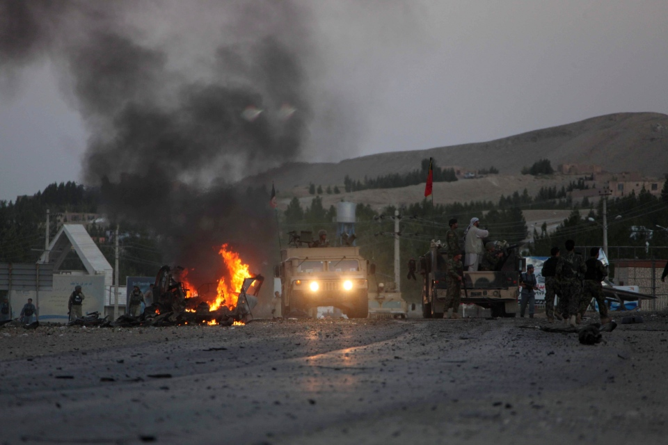 Smoke rises near the U.S. consulate after an attack by a car bomb and a gunfight in Herat Province, west of Kabul, Afghanistan, Friday, Sept. 13, 2013. (AP / Hoshang Hashimi)