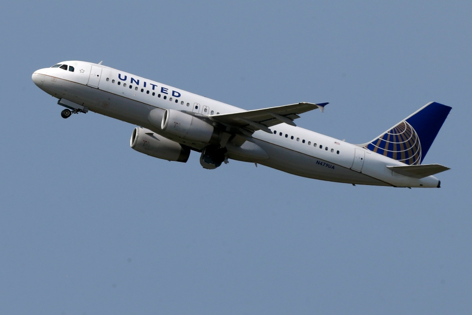 A United Airlines jet takes off from Pittsburgh International Airport in Imperial, Pa., Tuesday, July 23, 2013. (AP / Gene J. Puskar)
