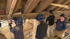 Workers are shown reconstructing the historic Bluenose II schooner in Lunenburg, N.S. in this undated image.
