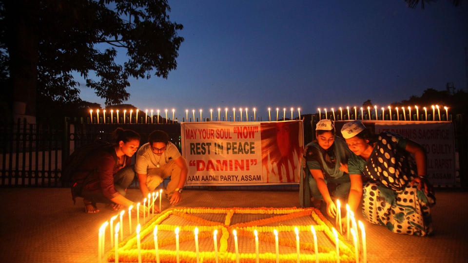 Indian people light candles to mark the verdict after a judge pronounced death sentences for four men convicted in the rape and murder of a student on a moving bus in New Delhi last year, in Gauhati, India, Friday, Sept. 13, 2013. (AP / Anupam Nath)